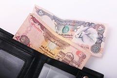 Wallet with Emirates Dirham. On white background stock photos