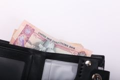 Wallet with Emirates Dirham. On white background royalty free stock image