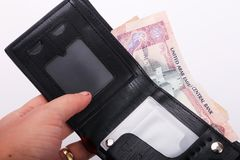 Wallet with Emirates Dirham. On white background stock images