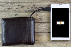 Wallet with energy charge Stock Photos