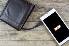 Wallet with energy charge Stock Photography