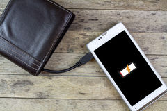 Wallet with energy charge Royalty Free Stock Images