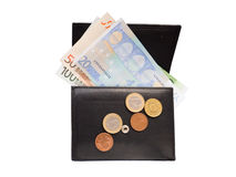 Wallet with euro banknotes and coins isolated on white. Open black leather wallet with euro banknotes and coins isolated on white Royalty Free Stock Images