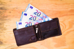 Wallet with Euro banknotes. Flat lay - wallet with Euro banknotes on wooden desk stock photography