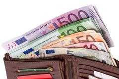 Wallet with euro banknotes. Open wallet with euro banknotes isolated on white background Royalty Free Stock Photos