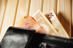 Wallet with Euro banknotes. On a table Royalty Free Stock Photos