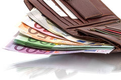 Wallet with euro banknotes on white. Open wallet with euro banknotes isolated on white background Royalty Free Stock Photography