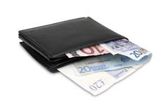 Wallet with euro and pound banknotes Stock Image
