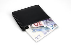 Wallet with euro and pound banknotes Stock Photography