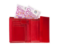 Wallet with euros. Red wallet with two five-hundred-euro banknotes isolated over a white background royalty free stock photos