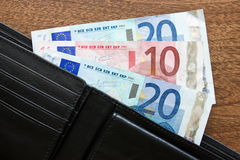 Wallet with euros on the table Royalty Free Stock Photography