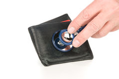 Wallet examined with stethoscope Stock Image