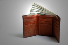Wallet filled with cash Stock Photos