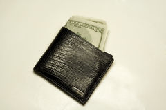 Wallet full of dollar bills. Isolated On White. $100 bank-notes Royalty Free Stock Images