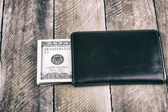 A wallet full of dollars Stock Photos