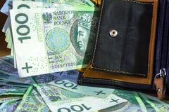 Wallet full of hundred zloty. Banknotes Royalty Free Stock Photo