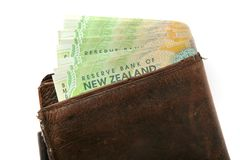 Wallet full of Kiwi money. Leather wallet with wad of $20 New Zealand bills hanging out of it Stock Photo