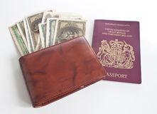 A wallet full of money and british passport royalty free stock photos