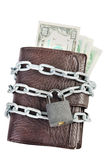 Wallet full of money is chained with a locked padlock Stock Photography