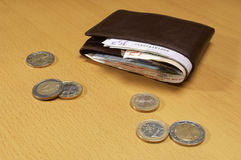 Wallet Full Of Money And Coins On Table Stock Photography