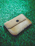 Wallet on grass Royalty Free Stock Photos