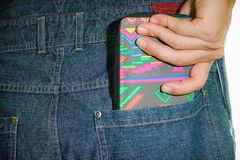 Wallet in Hand. A man taking out his wallet from his jean`s back pocket Royalty Free Stock Photo
