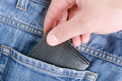 Wallet in hand. Stealing wallet from back pocket of jeans Royalty Free Stock Photo