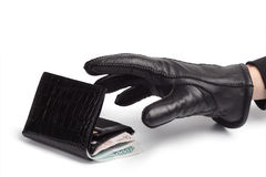 Wallet and hand of a thief. Hand of a thief stealing a wallet royalty free stock images