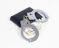 Wallet with handcuffs Stock Photos