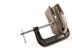 Wallet held in clamp. Leather wallet being held in clamp on white background stock images