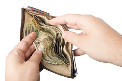 Wallet held open with cash. A wallet with cash (American dollars) being held open by a white male Royalty Free Stock Photos