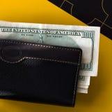 Wallet and hundred dollar banknotes Royalty Free Stock Photo