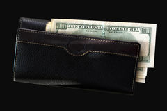 Wallet and hundred dollar banknotes Stock Photos