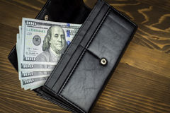 Wallet with hundred dollars Stock Photo