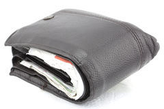 Wallet with isolated white back ground. Dark brown wallet full with credit card slips Royalty Free Stock Image