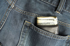 Wallet in jeans. Dollars showing in wallet in jeans back pocket Royalty Free Stock Photo