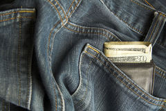 Wallet in jeans. Dollars showing in wallet in jeans back pocket Royalty Free Stock Images
