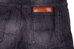 Wallet in jeans back pocket Royalty Free Stock Image