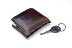 Wallet and key. A mens wallet and car key over a white background royalty free stock images