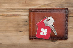 Wallet and key. On wood background Stock Images
