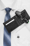 Wallet, keys  lying on the shirt  and tie Royalty Free Stock Image