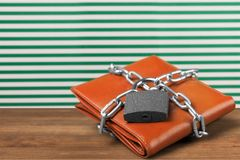 Wallet lock on table. Wallet lock protection chain strength security Royalty Free Stock Photo