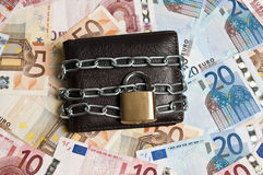 Wallet locked. Leather wallet locked with chain Stock Photography
