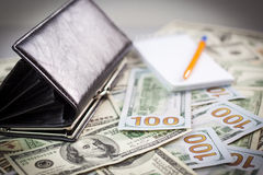 Wallet and a lot of american dollars Royalty Free Stock Photos