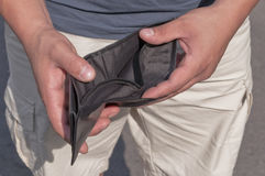 Wallet without money. Man shows his empty wallet Royalty Free Stock Images