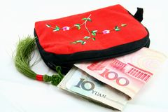 Wallet with money. Chinese tradition wallet with money on the white Stock Photos