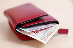 Wallet with Money. Open red leather wallet with euro banknotes Royalty Free Stock Images