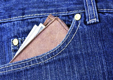Wallet with money in blue jeans.Man's style life Royalty Free Stock Photos