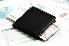Wallet with money on business document Stock Photo