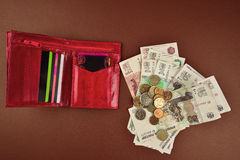 Wallet,money and coins Stock Images